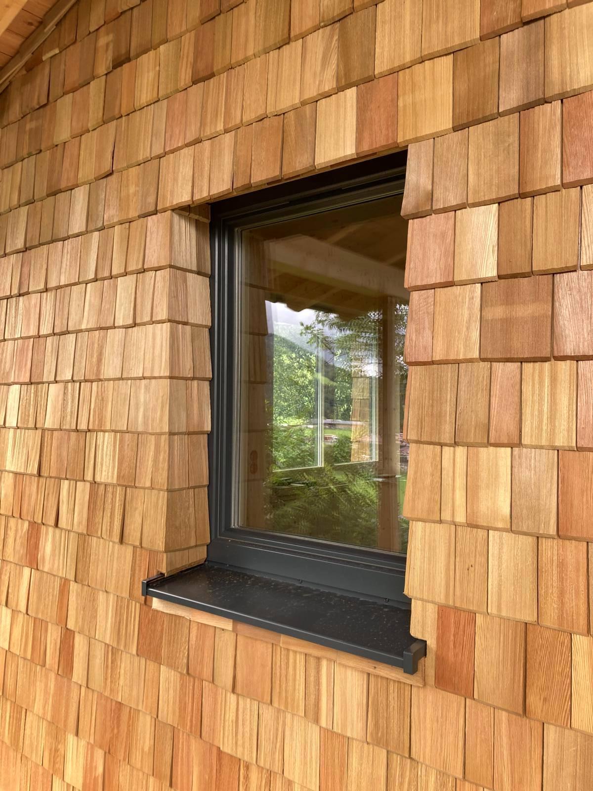 Thoma Holz100 Holz mit Lärchernfassade Fenster Ansicht